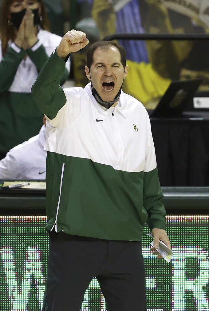 Baylor head coach Scott Drew reacts as his team scores in the second half of an NCAA college basketball game against Texas Tech Sunday, March 7, 2021, in Waco, Texas. (AP Photo/Jerry Larson)
