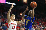 South Dakota State guard Brandon Key, right, shoots over Arizona forward Stone Gettings (13) in the first half during an NCAA college basketball game, Thursday, Nov. 21, 2019, in Tucson, Ariz. (AP Photo/Rick Scuteri)