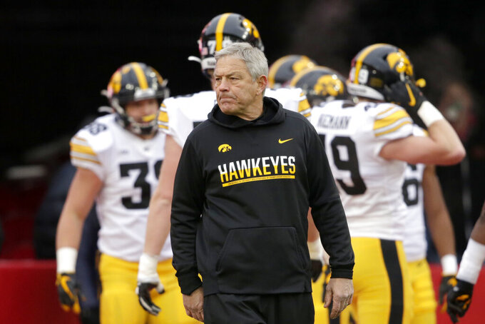 FILE-  In this Nov. 29, 2019, file photo, Iowa head coach Kirk Ferentz follows warmups before an NCAA college football game against Nebraska in Lincoln, Neb. (AP Photo/Nati Harnik, File)