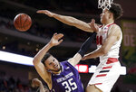 Nebraska's Isaiah Roby (15) blocks a shot by Northwestern's Aaron Falzon (35) during the second half of an NCAA college basketball game in Lincoln, Neb., Saturday, Feb. 16, 2019. (AP Photo/Nati Harnik)