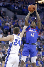 DePaul's Darious Hall (13) shoots over Creighton's Mitch Ballock (24) during the first half of an NCAA college basketball game in Omaha, Neb., Saturday, Feb. 15, 2020. (AP Photo/Nati Harnik)
