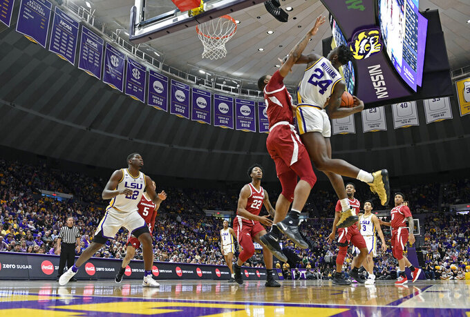 Arkansas forward Reggie Chaney defends against LSU forward Emmitt Williams (24) during the first half of an NCAA college basketball game Saturday, Feb. 2, 2019, in Baton Rouge, La. (AP Photo/Bill Feig)