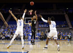 Colorado guard Shane Gatling (0) makes a 3-point basket over UCLA guard Jules Bernard (3) and guard David Singleton (34) during the first half of an NCAA college basketball game Wednesday, Feb. 6, 2019, in Los Angeles. (AP Photo/Marcio Jose Sanchez)