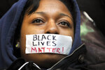 FILE - In this Dec. 2, 2014, file photo, Penn State student Zaniya Joe wears a piece of tape over her mouth that says Black Lives Matter, as a group of Penn State University students protest in University Park, Pa., following events in Ferguson, Mo. Nationally, the phrase Black Lives Matter was praised for its clarity and attacked as strident and offensive to police. But support grew as the list of slain black people got longer: Michael Brown, Eric Garner, Walter Scott, Alton Sterling, Philando Castile. (Nabil K. Mark/Centre Daily Times via AP, File)