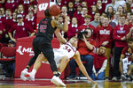 Wisconsin's Brad Davison (34) fouls Rutgers' Jacob Young (42) during the second half of an NCAA college basketball game Sunday, Feb. 23, 2020, in Madison, Wis. Wisconsin won 79-71. (AP Photo/Andy Manis)
