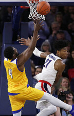 Cal State Bakersfield forward James Suber (4) shoots while defended by Gonzaga forward Rui Hachimura (21) during the first half of an NCAA college basketball game in Spokane, Wash., Monday, Dec. 31, 2018. (AP Photo/Young Kwak)