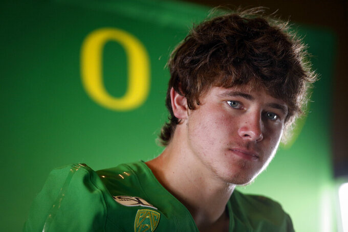 Oregon senior quarterback Justin Herbert talks to reporters during the NCAA college football team's media day Friday, Aug. 2, 2019, in Eugene, Ore. (Andy Nelson/The Register-Guard via AP)