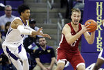 Washington State forward Jeff Pollard, right, looks to pass around Washington guard Matisse Thybulle, left, during the first half of an NCAA college basketball game, Saturday, Jan. 5, 2019, in Seattle. (AP Photo/Ted S. Warren)