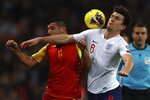 England's Harry Maguire, right, and Montenegro's Fatos Beciraj fight for the ball during the Euro 2020 group A qualifying soccer match between England and Montenegro at Wembley stadium in London, Thursday, Nov. 14, 2019. (AP Photo/Ian Walton)