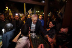 Blue and White party leader Benny Gantz visits downtown Tel Aviv, Israel, as a part of his election campaign, Thursday, Feb. 13, 2020. (AP Photo/Sebastian Scheiner)