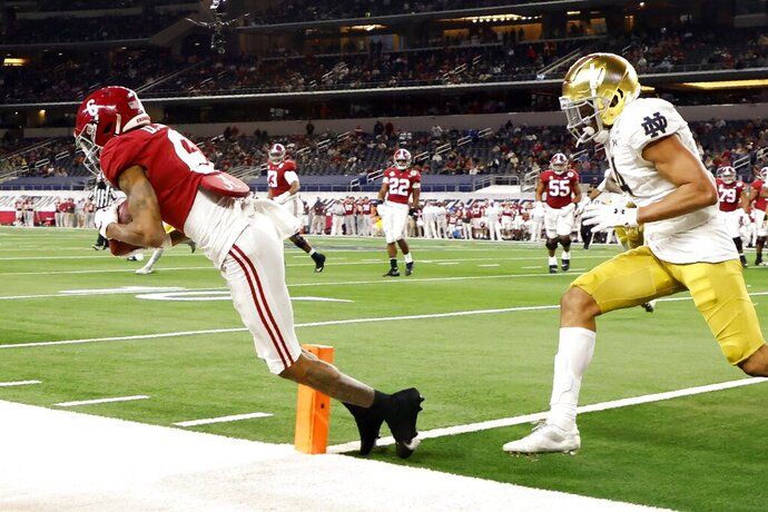 Alabama wide receiver DeVonta Smith (6) catches a pass in the end zone for a touchdown as Notre Dame cornerback Nick McCloud, right, defends in the second half of the Rose Bowl NCAA college football game in Arlington, Texas, Friday, Jan. 1, 2021. (AP Photo/Michael Ainsworth)