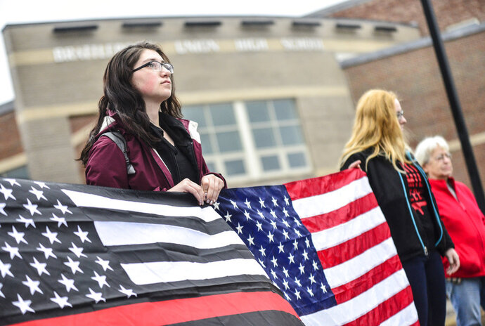 Megan Pennell, a 12th grader at Brattleboro Union High School, stands with fellow students outside the school in Brattleboro, Vt., on Friday, March 30, 2018, before the start of classes to hold a rally in support of the Second Amendment and gun rights. (Kristopher Radder/The Brattleboro Reformer via AP)