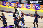 Norfolk State's Devante Carter (14) goes up for a dunk against Morgan State during the first half of of an NCAA college basketball game in the championship of the Mid-Eastern Athletic Conference tournament at the Scope Arena on Saturday, March 13, 2021, in Norfolk, Va. (AP Photo/Mike Caudill)