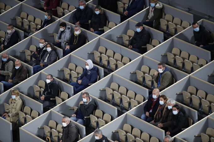 Spectators watch Austria's Dominic Thiem and Croatia's Marin Cilic play their first round match of the French Open tennis tournament in center court Philippe Chatrier at the Roland Garros stadium in Paris, France, Monday, Sept. 28, 2020. (AP Photo/Alessandra Tarantino)