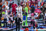 People steer their SUP boards during a SUP (Stand Up Paddle)-Surfing festival at Krylatskoye Olympic rowing canal in Moscow, Russia, Sunday, Sept. 12, 2021. (AP Photo/Pavel Golovkin)
