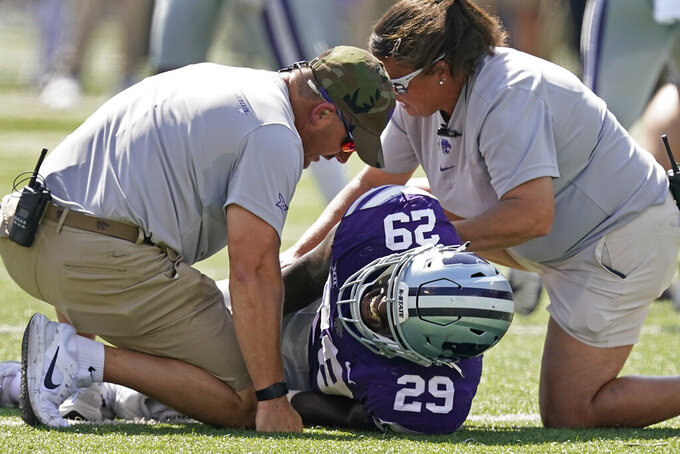 Kansas State defensive end Khalid Duke (29) is helped after being injured during the first half of an NCAA college football game against Nevada Saturday, Sept. 18, 2021, in Manhattan, Kan. (AP Photo/Charlie Riedel)