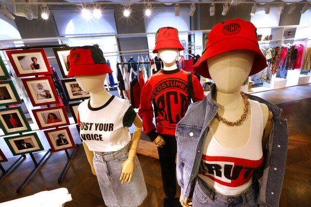"In this Feb. 20, 2020, photo, items from H&M's new street wear collection are displayed at a store in New York. The collection was designed in collaboration with Ruth Carter, the Academy-Award winning designer behind the costumes for films such as ""Black Panther"" and ""Malcolm X."
