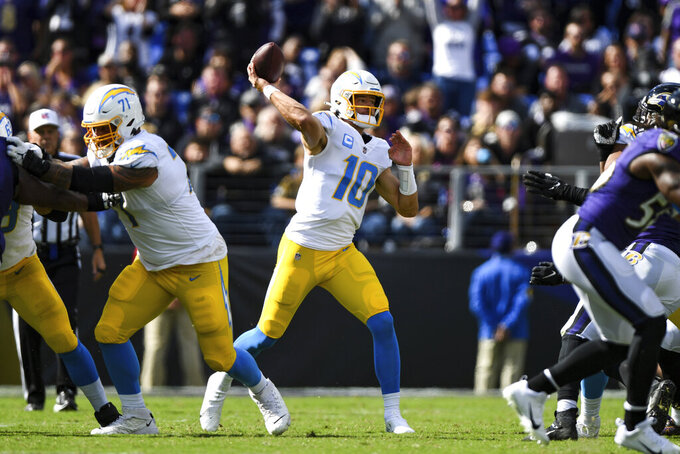 Los Angeles Chargers quarterback Justin Herbert (10) throws the ball during the second quarter of an NFL football game against the Baltimore Ravens, Sunday, Oct. 17, 2021, in Baltimore. (AP Photo/Terrance Williams)