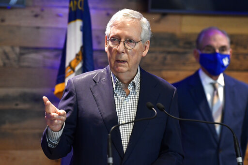Senate Minority Leader Mitch McConnell, R-Ky., listens to a reporters question during a press conference at a COVID vaccination site in Lexington, Ky., Monday, April 5, 2021. (AP Photo/Timothy D. Easley)
