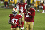 San Francisco 49ers cornerback Jamar Taylor (47) and defensive end Kerry Hyder Jr. (92) walk off the field after ther 49ers lost to the Green Bay Packers in an NFL football game in Santa Clara, Calif., Thursday, Nov. 5, 2020. (AP Photo/Jed Jacobsohn)