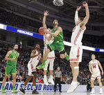 FILE - In this March 22, 2019, file photo, Oregon guard Ehab Amin shoots against Wisconsin during the first half of a first-round game in the NCAA men's college basketball tournament, in San Jose, Calif. Ehab Amin is doing his best to make the Egyptian's lone season at Oregon memorable. The senior who transferred after graduating from Texas A&M Corpus Christi has helped the Ducks reach the Sweet 16 with his energy both on and off the bench disrupting opponents. (AP Photo/Chris Carlson, File)
