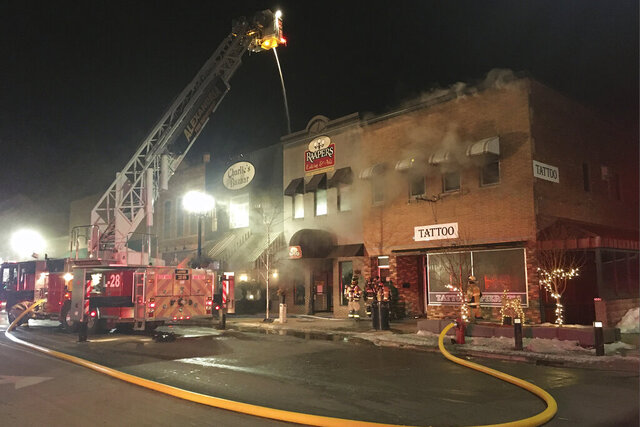 This photo provided by Douglas County (Minn.) Emergency Management in Alexandria, Minn., shows firefighters fighting a fire Tuesday, Feb. 25, 2020 that destroyed several buildings in downtown Alexandria. (Julie Anderson/Douglas County Emergency Management via AP)