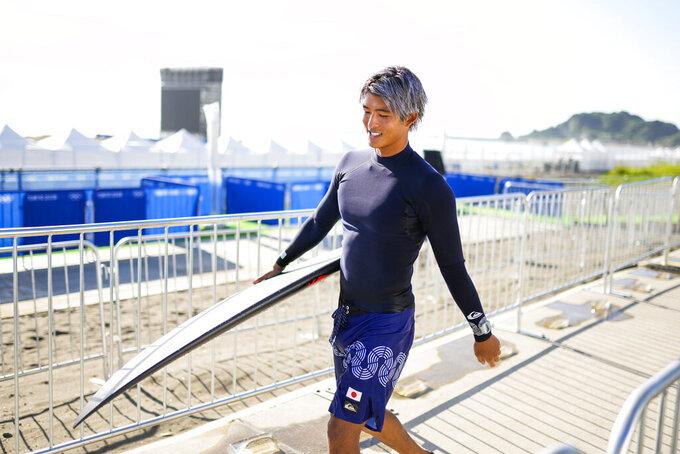 Japan's Kanoa Igarashi leaves after a training session at the 2020 Summer Olympics, Friday, July 23, 2021, at Tsurigasaki beach in Ichinomiya, Japan. (AP Photo/Francisco Seco)