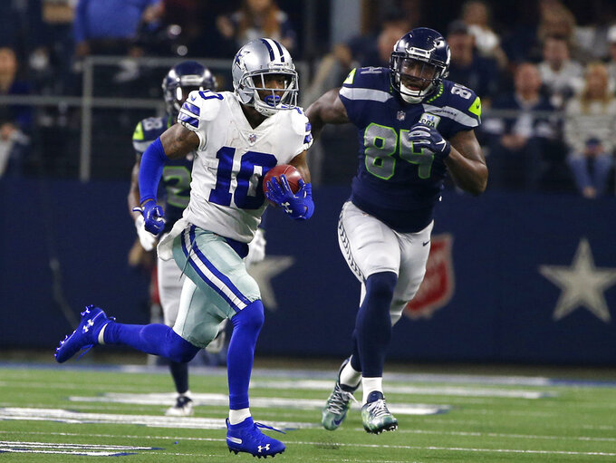 FILE - In this Jan. 5, 2019, file photo, Dallas Cowboys' Tavon Austin (10) returns a punt for a long gain as Seattle Seahawks' Ed Dickson gives chase during an NFC wild-card NFL football game in Arlington, Texas. Austin's fresh start with the Cowboys wasn't much different than the stale final season the versatile receiver endured with the Los Angeles Rams. The difference is that Austin has a chance to change the feeling, against his former team no less, in the divisional round of the playoffs. The Cowboys traded for Austin during the draft, but he missed nine games after injuring a groin. (AP Photo/Ron Jenkins, File)