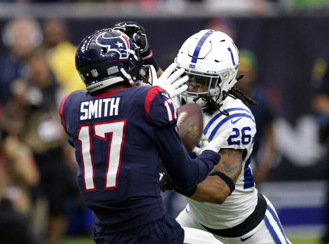 Indianapolis Colts strong safety Clayton Geathers (26) breaks up a pass intended for Houston Texans wide receiver Vyncint Smith (17) during the first half of an NFL wild card playoff football game, Saturday, Jan. 5, 2019, in Houston. (AP Photo/Michael Wyke)
