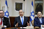 Israeli Prime Minister Benjamin Netanyahu chairs the weekly cabinet meeting, in Jerusalem, Sunday, Feb. 16, 2020. (Gali Tibbon/Pool via AP)