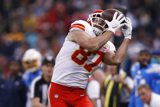 Kansas City Chiefs tight end Travis Kelce hauls in a pass against his helmet during the first half of an NFL football game against the Los Angeles Chargers Monday, Nov. 18, 2019, in Mexico City. (AP Photo/Rebecca Blackwell)