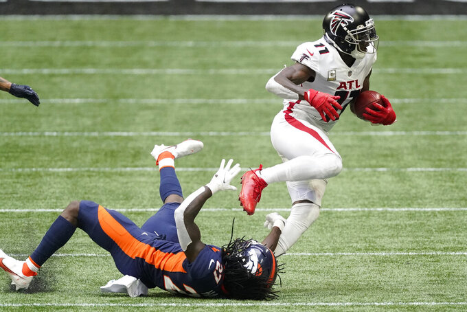 Denver Broncos cornerback Horace Richardson (27) falls covering Atlanta Falcons wide receiver Julio Jones (11) during the first half of an NFL football game, Sunday, Nov. 8, 2020, in Atlanta. (AP Photo/John Bazemore)