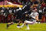 Oklahoma running back Austin Stogner (18) is tackled by Iowa State defensive back Isheem Young (1) and defensive back Greg Eisworth II (12) after making a reception during the second half an NCAA college football game, Saturday, Oct. 3, 2020, in Ames, Iowa. Iowa State won 37-30. (AP Photo/Charlie Neibergall)