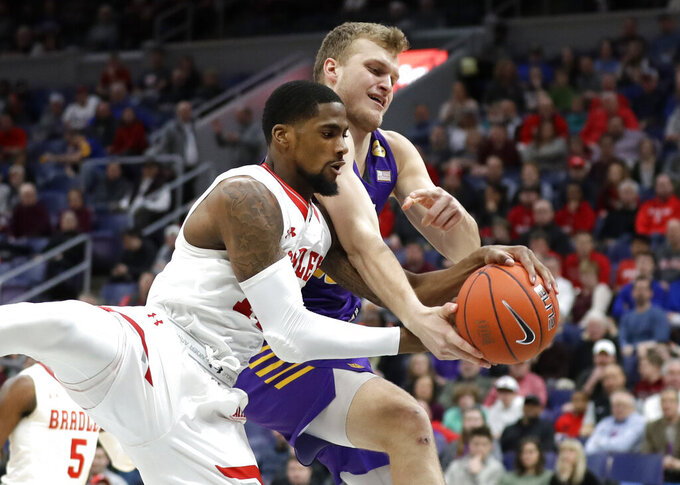 Bradley's Elijah Childs, left, and Northern Iowa's Justin Dahl reach for a rebound during the first half of an NCAA college basketball game in the championship of the Missouri Valley Conference tournament, Sunday, March 10, 2019, in St. Louis. (AP Photo/Jeff Roberson)