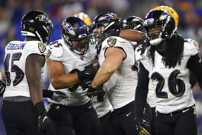 Baltimore Ravens fullback Patrick Ricard, center, celebrates with teammates after collecting a Green Bay Packers fumble during the second half of an NFL football preseason game, Thursday, Aug. 15, 2019, in Baltimore. (AP Photo/Nick Wass)