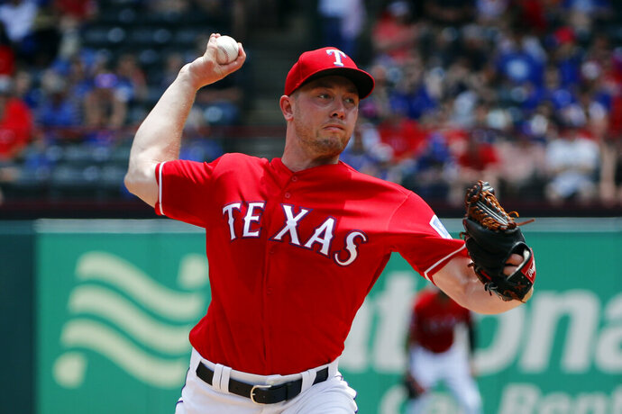 Texas Rangers starting pitcher Adrian Sampson throws to the Kansas City Royals in the first inning of a baseball game in Arlington, Texas, Sunday, June 2, 2019. (AP Photo/Tony Gutierrez)