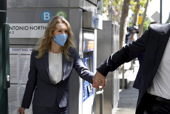 Elizabeth Holmes leaves the United States Federal Courthouse in San Jose, Calif., Wednesday, Sept. 8, 2021. Her company Theranos failed in 2018, a few years after a series of explosive stories in The Wall Street Journal exposed serious flaws in its technology and spurred regulatory investigations that shut down the testing. (AP Photo/Nic Coury)