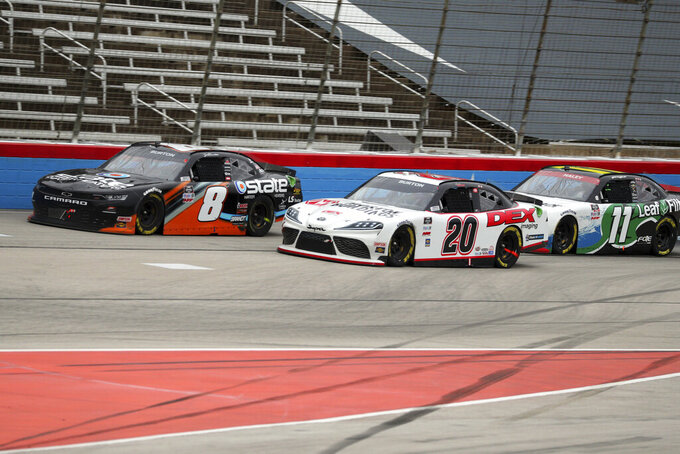 Xfinity Series drivers Jeb Burton (8), Harrison Burton (20) and Justin Haley (11) come out of turn four during a NASCAR Xfinity Series auto race at Texas Motor Speedway in Fort Worth, Texas, Saturday Oct. 24, 2020. (AP Photo/Richard W. Rodriguez)