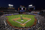 The New York Yankees and the New York Mets line up together along the baselines for the 20th anniversary of the 9/11 terrorist attacks before a baseball game on Saturday, Sept. 11, 2021, in New York. (AP Photo/Adam Hunger)