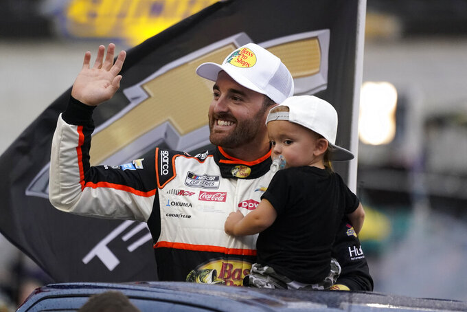 Austin Dillon waves to fans before a NASCAR Cup Series auto race at Bristol Motor Speedway Saturday, Sept. 18, 2021, in Bristol, Tenn. (AP Photo/Mark Humphrey)