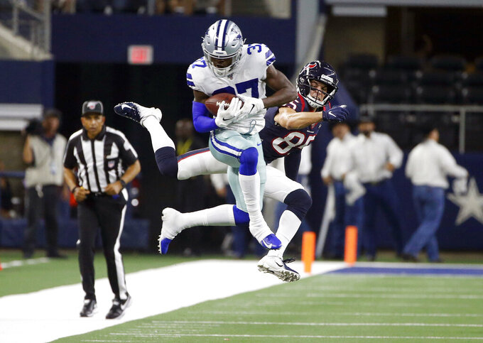 Dallas Cowboys defensive back Donovan Wilson (37) intercepts a pass intended for Houston Texans wide receiver Chad Hansen (85) in the second half of a preseason NFL football game in Arlington, Texas, Saturday, Aug. 24, 2019. (AP Photo/Ron Jenkins)
