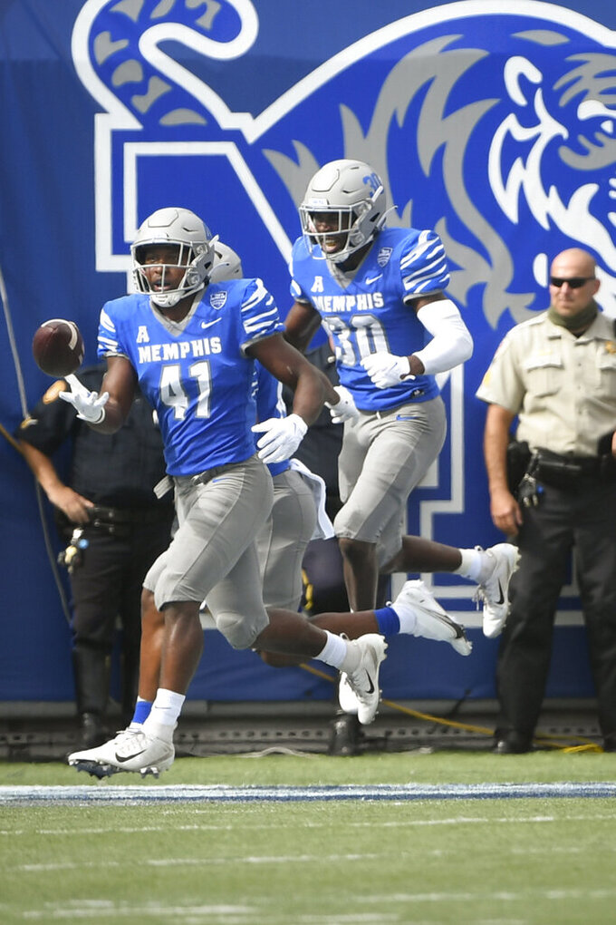 Memphis defensive back Sanchez Blake Jr. (41) celebrates his touchdown with defensive back Rodney Owens (30) after recovering a fumble and running for a touchdown against Mississippi State during the first half of an NCAA college football game on Saturday, Sept. 18, 2021, in Memphis, Tenn. (AP Photo/John Amis)