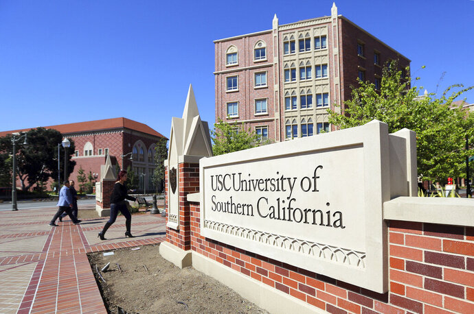 FILE - This March 12, 2019, file photo shows the University Village area of the University of Southern California, in Los Angeles. A California couple has agreed to plead guilty to paying $250,000 to get their daughter into the University of Southern California as a fake volleyball recruit. (AP Photo/Reed Saxon, File)