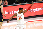 Maryland forward Jairus Hamilton reacts after a shot during the first half of the team's NCAA college basketball game against Michigan, Thursday, Dec. 31, 2020, in College Park, Md. (AP Photo/Nick Wass)