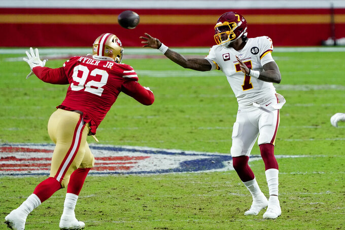 Washington Football Team quarterback Dwayne Haskins (7) throws as San Francisco 49ers defensive end Kerry Hyder (92) defends during the second half of an NFL football game, Sunday, Dec. 13, 2020, in Glendale, Ariz. (AP Photo/Rick Scuteri)