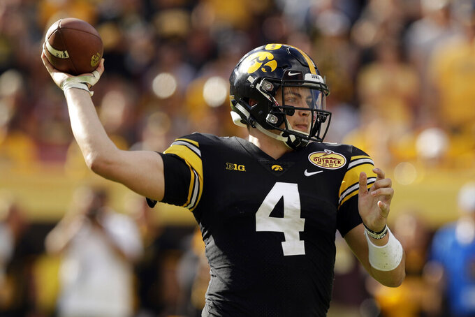 FILE - In this Jan. 1, 2019, file photo, Iowa quarterback Nate Stanley throws a pass against Mississippi State during the second half of the Outback Bowl NCAA college football game Tuesday,, in Tampa, Fla. Stanley threw for 52 touchdowns in his first two seasons as a starter, the most in school history, and he's just 23 more scores away from passing Heisman Trophy runner-up Chuck Long for the No. 1 spot. And while Stanley has over 5,000 fewer yards passing than Long did, he's within striking distance of Drew Tate for second on that list. (AP Photo/Chris O'Meara, File)