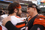 Cincinnati Bengals quarterback Andy Dalton, right, and Cleveland Browns quarterback Baker Mayfield talk after the Bengals defeated the Browns in an NFL football game, Sunday, Dec. 29, 2019, in Cincinnati. (AP Photo/Bryan Woolston)