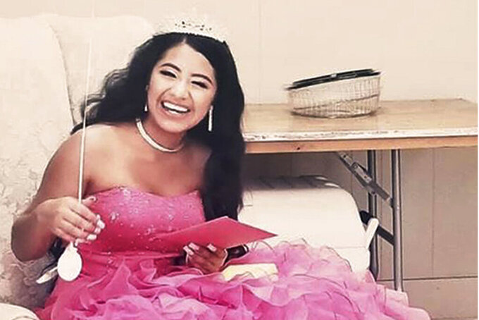 """In this February 2021 photo provided by Caring Place@ Miami Rescue Mission, Adriana Palma wears a tiara and ballgown on her quinceanera, her 15th birthday celebration. Quinceaneras are revered in Hispanic culture and celebrated with all the gusto of a wedding. But after her father lost his job, Adriana said, """"I lost all hope of having one."""" (Caring Place@ Miami Rescue Mission via AP)"""
