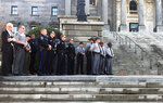 Members of law enforcement stand in support of an expanded interlock ignition legislation Tuesday, Feb. 12, 2019 at the South Carolina Statehouse in Columbia, S.C. (AP Photo/Christina L. Myers)