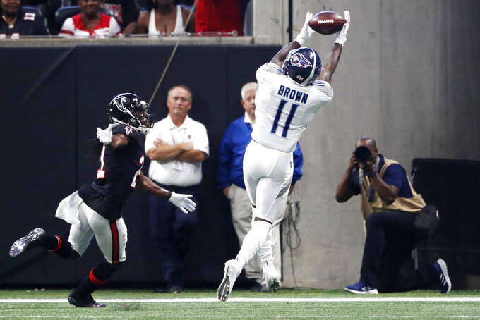 Tennessee Titans wide receiver A.J. Brown (11) makes a touchdown catch ahead of Atlanta Falcons cornerback Desmond Trufant (21) during the first half of an NFL football game, Sunday, Sept. 29, 2019, in Atlanta. (AP Photo/John Bazemore)